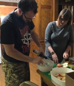Microgrant Recipient Ben cooks with the help of his registered dietician