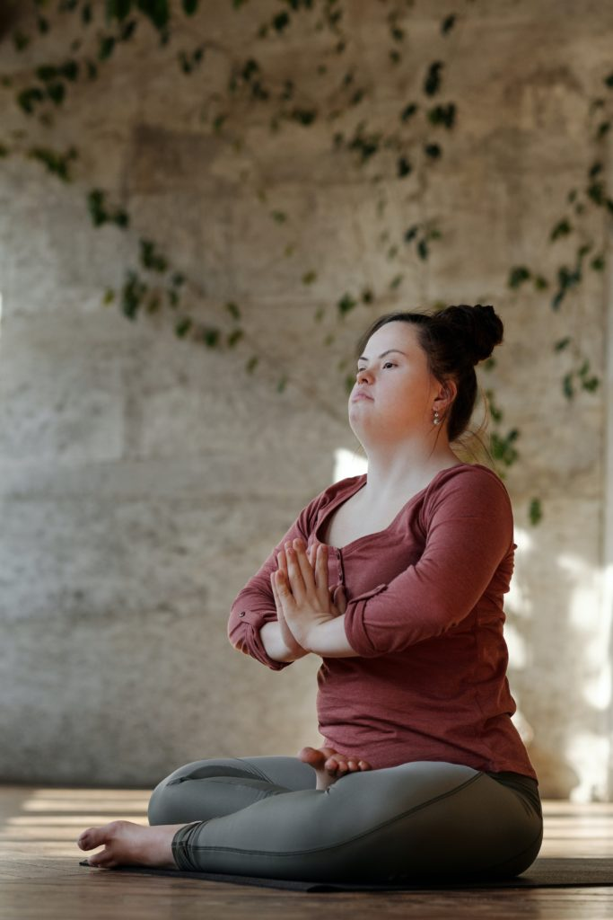 Woman with Down Syndrome meditating